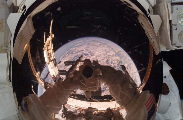 Cool reflection of Earth in an astronauts mirrored visor!